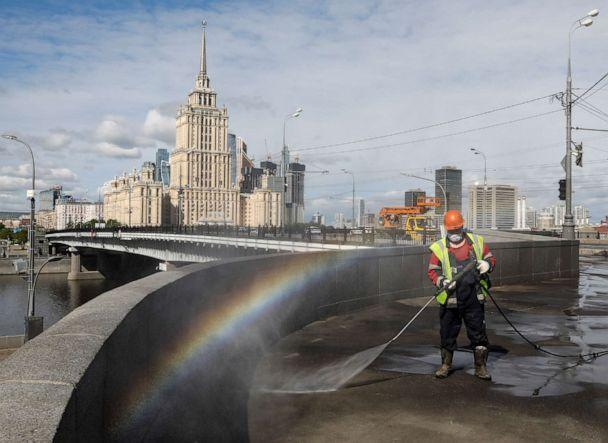PHOTO: A specialist sprays disinfectant while sanitizing a bridge amid the outbreak of the novel coronavirus in Moscow, Russia, on May 16, 2020. (Shamil Zhumatov/Reuters)