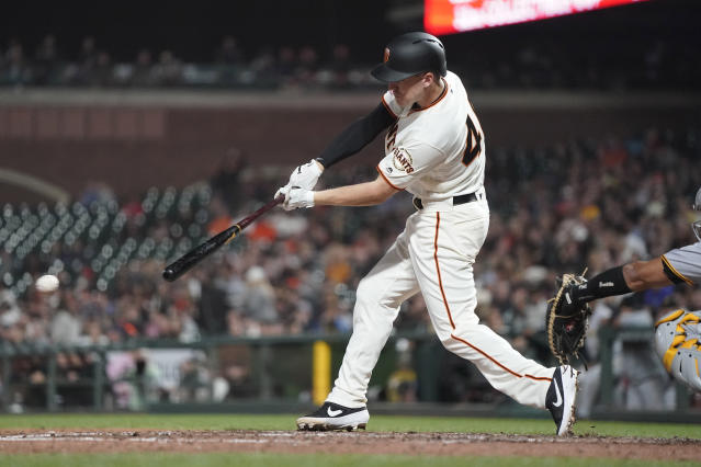 San Francisco Giants' Corban Joseph hits a grounder that scored a run against the Pittsburgh Pirates during the fifth inning of a baseball game Wednesday, Sept. 11, 2019, in San Francisco. (AP Photo/Tony Avelar)