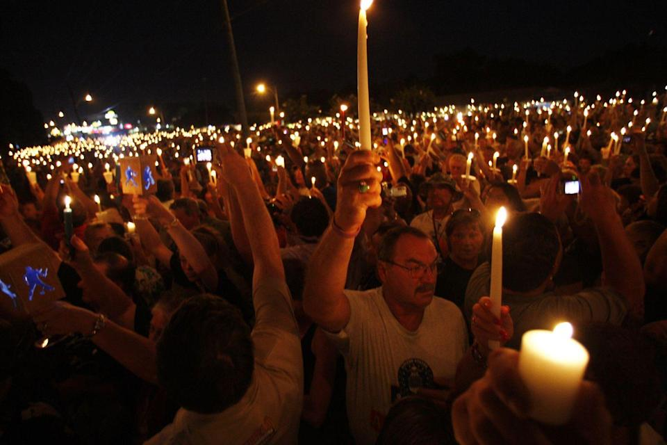 <p>On the 30th anniversary of Elvis's death in 2007, thousands of devoted fans gathered at Graceland for a candlelight vigil and to experience his films and music on his historic property. </p>