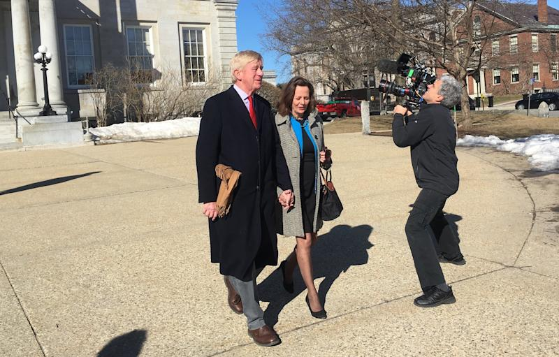 Former Massachusetts Gov. Bill Weld and wife Leslie Marshall leave the New Hampshire statehouse in Concord after a recent visit as a campaign film crew shoots footage.