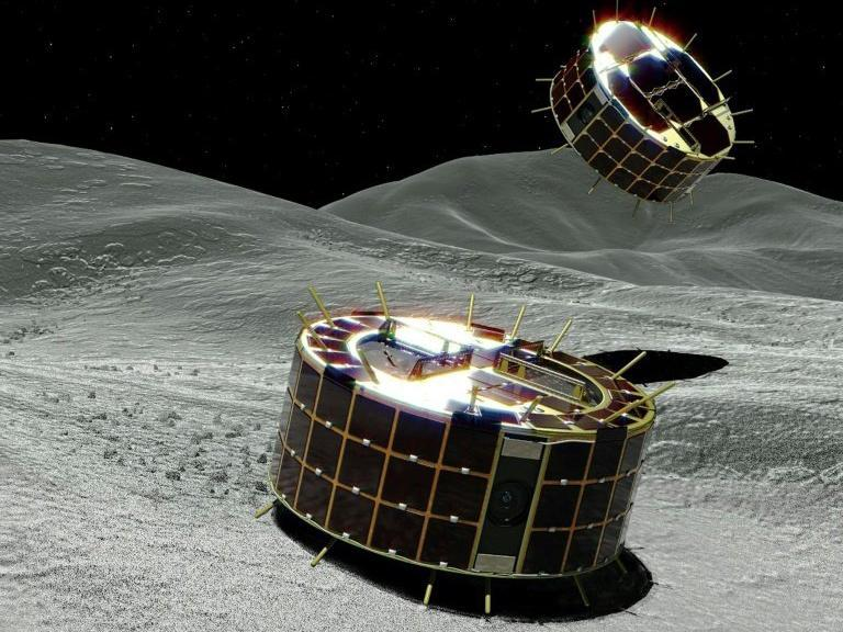Artists impression of the Minerva-II-1 rovers landing on the surface of the Ryugu asteroid: JAXA