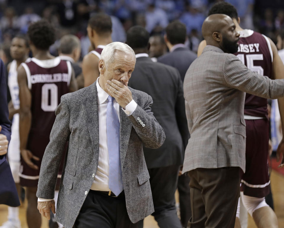 North Carolina head coach Roy Williams walks off the court after a second-round loss against Texas A&M in the NCAA tournament Sunday. (AP Photo/Gerry Broome)