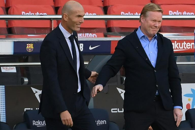 Zinedine Zidane (left) and Ronald Koeman (right) greet each other at the Clasico on Saturday.