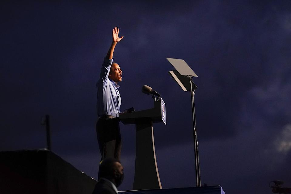 Obama waves after speaking at the election rally as he campaigns for Joe Biden (AP)