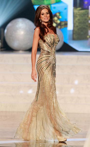 <b>Miss Universe 2012 </b><br><br>Finalist Miss Brazil Gabriela Markus sashays down the stage in a gold sequinned frock.<br><br>© Getty