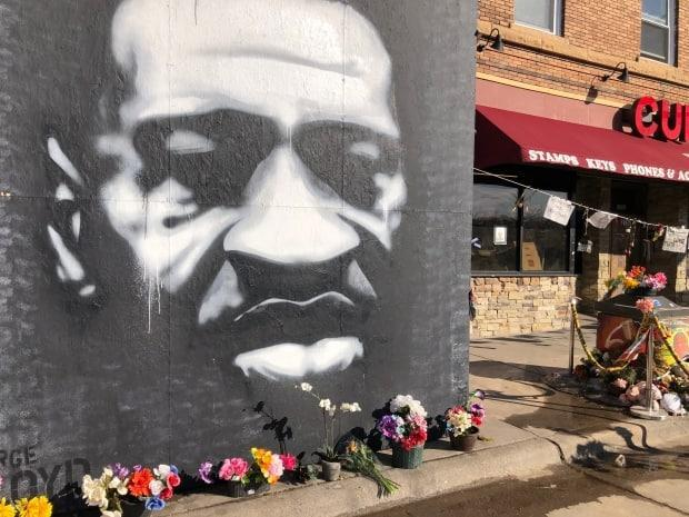 A mural of George Floyd stands in Minneapolis near the site of where he was killed by police in May 2020. Jury selection for the trial of Derek Chauvin is expected to begin this week. (Sylvia Thomson/CBC - image credit)