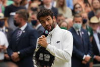 Italy's Matteo Berrettini holds his runners-up trophy and speaks after the men's singles final match against Serbia's Novak Djokovic on day thirteen of the Wimbledon Tennis Championships in London, Sunday, July 11, 2021. (AP Photo/Alberto Pezzali)