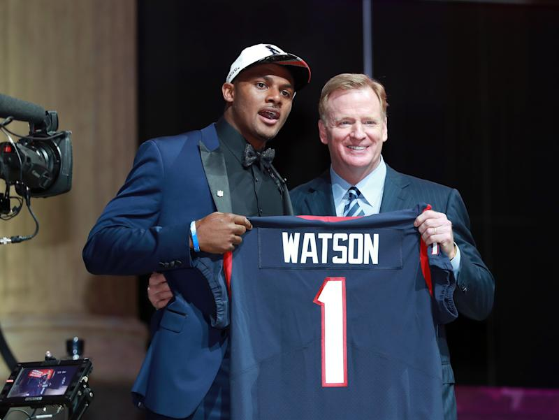 Deshaun Watson posed with Roger Goodell at last year's draft wearing a brand new draft-day hat. (AP)