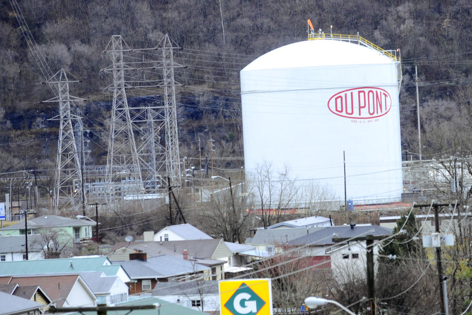 A DuPont plant silo sits near a residential area in Marmet, W.Va. Monday, Jan. 25, 2010. Federal officials are investigating a series of leaks that shut down the chemical plant  and resulted in the death of one worker. (AP Photo/Jeff Gentner)