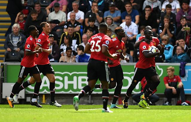 Eric Bailly leads the celebrations after putting Manchester United ahead