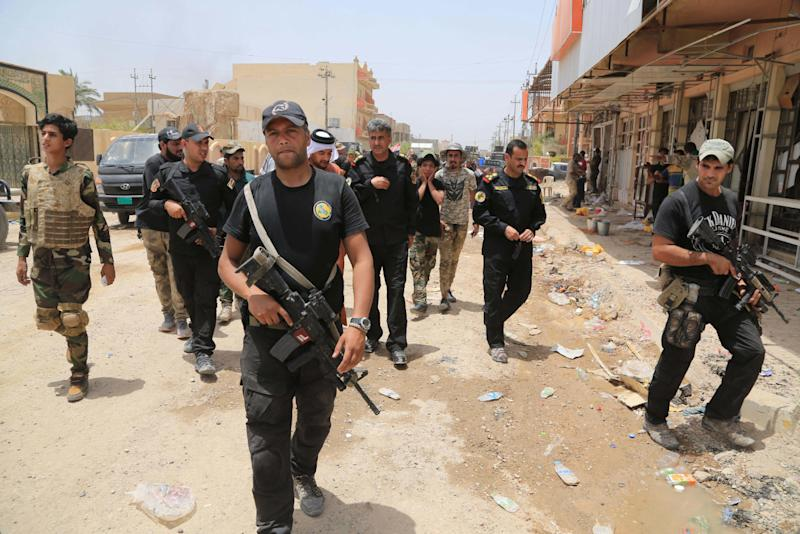 Iraqi security forces patrol Fallujah, Iraq, Tuesday, June 28, 2016. Iraqi officials say dozens of homes have been burned and looted as Fallujah was liberated from the Islamic State group. (AP Photo/Karim Kadim)