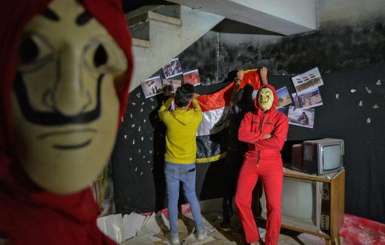 Like activists elsewhere, the Iraqi performers borrow from popular culture, in this case donning the red jumpsuits and Dali masks of the Spanish Netflix hit series La Casa de Papel