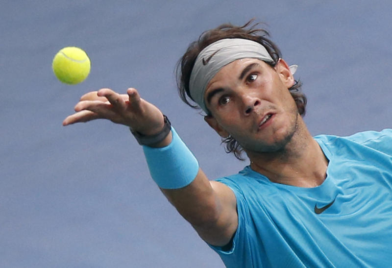 Rafael Nadal of Spain serves the ball to David Ferrer of Spain during their semi final match, at the Paris Masters tennis at Bercy Arena in Paris, France, Saturday, Nov. 2, 2013. (AP Photo/Francois Mori)
