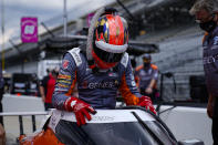 James Hinchcliffe, of Canada, climbs into his car during practice for the Indianapolis 500 auto race at Indianapolis Motor Speedway in Indianapolis, Wednesday, Aug. 12, 2020. (AP Photo/Michael Conroy)