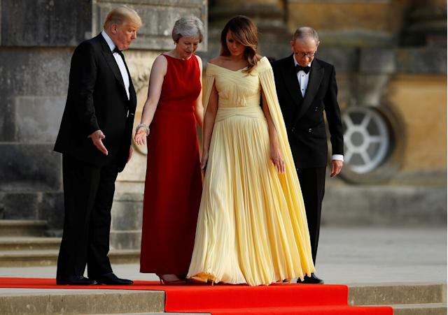 <p>British Prime Minister Theresa May and her husband Philip stand together with President Donald Trump and first lady Melania Trump at the entrance to Blenheim Palace, where they are attending a dinner with specially invited guests and business leaders, near Oxford, Britain, July 12, 2018. (Photo: Peter Nicholls/Reuters) </p>