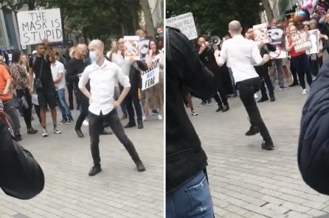 Funny moment man challenges anti-mask protesters to dance off
