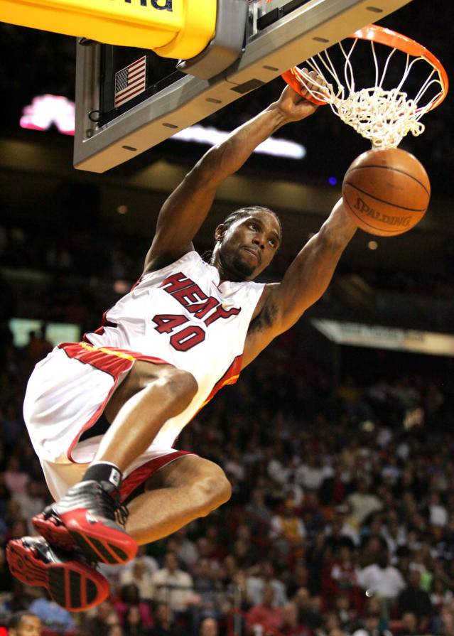 FILE - In this Jan. 1, 2005, file photo, Miami Heat's Udonis Haslem (40) dunks during the third quarter against the Charlotte Bobcats, in Miami. Haslem's name was never called on draft night in 2003. Most of the players picked that year are long gone: only eight of the 58 selections played in the NBA this past season. Haslem is still around, though, and his story serves as a reminder: Getting taken in the draft doesn't guarantee much. (AP Photo/Luis M. Alvarez, FIle)