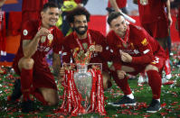 Liverpool players (from left) Dejan Lovren, Mohamed Salah and Xherdan Shaqiri celebrate with the Premier League trophy. (PHOTO: Phil Noble/Pool via Getty Images)