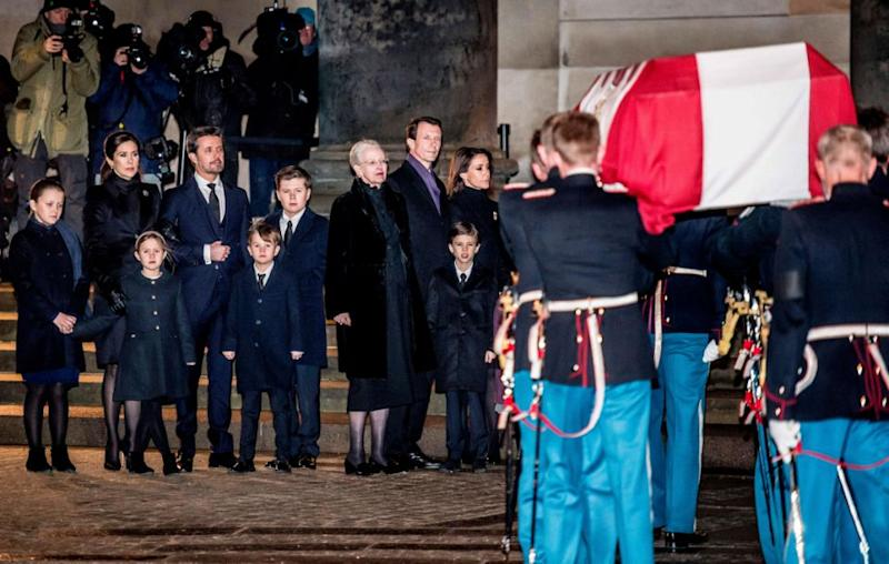 Princess Mary, her children and the rest of the devastated Danish royal family watched on as Prince Henrik's coffin arrived at Christiansborg Palace on Friday. Source: MADS CLAUS RASMUSSEN/AFP/Getty Images