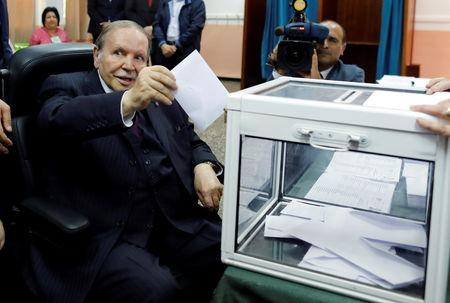 FILE PHOTO:  Algeria's President Abdelaziz Bouteflika casts his ballot during the parliamentary election in Algiers