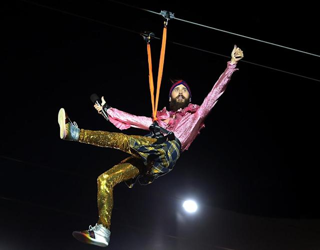 <p>It's a bird! It's a plane! It's… Jared Leto? The singer-slash-actor started his performance with his band, Thirty Seconds to Mars, by ziplining to the stage at the Rock in Rio music festival in Brazil. (Photo: GADE/Backgrid) </p>