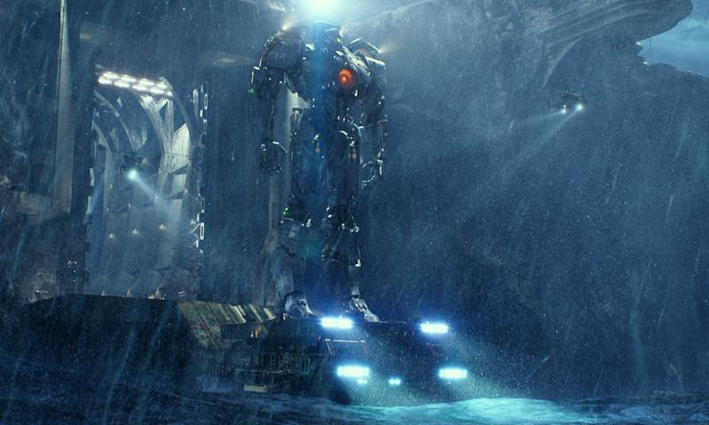 """This film publicity image released by Warner Bros. Pictures shows the Gipsy Danger robot in a scene from """"Pacific Rim."""" (AP Photo/Warner Bros. Pictures)"""
