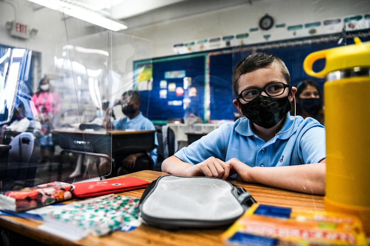 Student wear facemasks as they attend their first day in school after summer vacation at the St. Lawrence Catholic School  in north of Miami, on August 18, 2021. (Chandan Khanna/AFP via Getty Images)