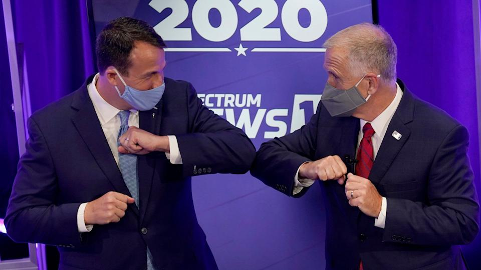 Mandatory Credit: Photo by Gerry Broome/AP/Shutterstock (10826400u)Democratic challenger Cal Cunningham, left, and U.