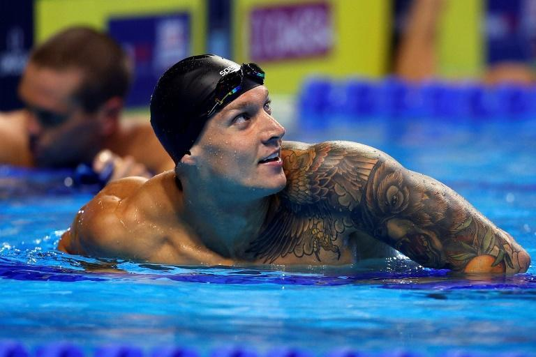 Caeleb Dressel reacts after winning the 100m butterfly at the US Olympic swimming trials