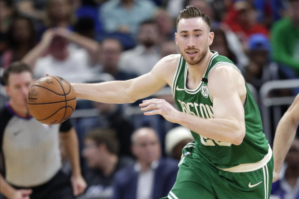 FILE - In this Jan. 24, 2020, file photo, Boston Celtics forward Gordon Hayward moves the ball on a fast break against the Orlando Magic during the second half of an NBA basketball game in Orlando, Fla. Hayward has been a player that the Charlotte Hornets have wanted for years. On Saturday, Nov. 21, 2020, they finally landed him, according to Priority Sports, the agency that represents the veteran forward. ESPN, which first reported the agreement, said Hayward would sign a four-year deal worth $120 million. (AP Photo/John Raoux, File)