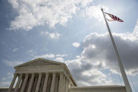 File photo of the U.S. flag flying in front of the Supreme Court in Washington