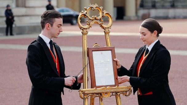 PHOTO: Members of staff set up an official notice on an easel at the gates of Buckingham Palace in London on May 6, 2019 announcing the birth of a son to Britain's Prince Harry, Duke of Sussex and Meghan, Duchess of Sussex. (Tolga Akmen/AFP/Getty Images)