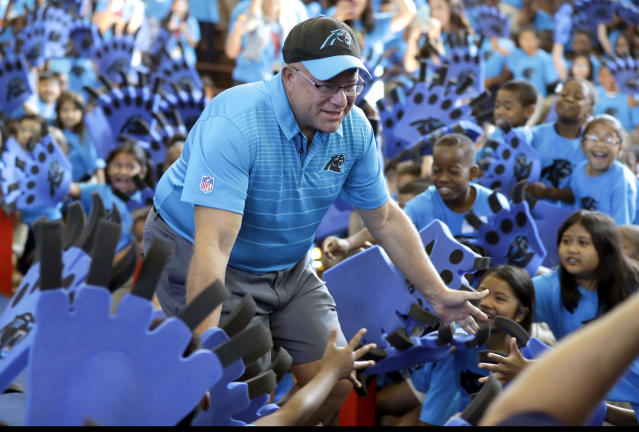 "Carolina Panthers owner David Tepper greets students during a ""kickoff rally"" at Thomasboro Academy in Charlotte, N.C., Tuesday, Aug. 28, 2018. Tepper's charitable foundation along with several players groups and other partners will provide over 12,000 backpacks full of supplies to 17 elementary schools in Charlotte-Mecklenburg Schools, as well as an additional school in Kannapolis City Schools. (AP Photo/Chuck Burton)"