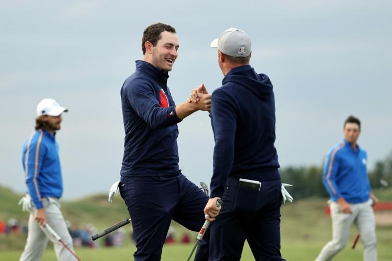 Americans Justin Thomas and Patrick Cantlay celebrate as they rally to tie Europe's Tommy Fleetwood and Viktor Hovland in a Ryder Cup four-balls at Whistling Straits (AFP/Warren Little)