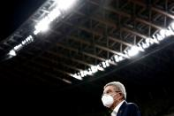 FILE PHOTO: Thomas Bach, International Olympic Committee (IOC) President speaks to the media as he visits the National Stadium, the main venue for the 2020 Olympic and Paralympic Games, in Tokyo