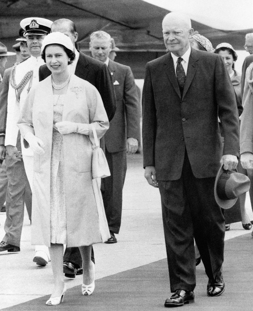 The Queen and President Dwight D. Eisenhower of America leaving the airstrip at St. Hubert, Quebec, where her Majesty greeted the President and his wife on their arrival in Canada.