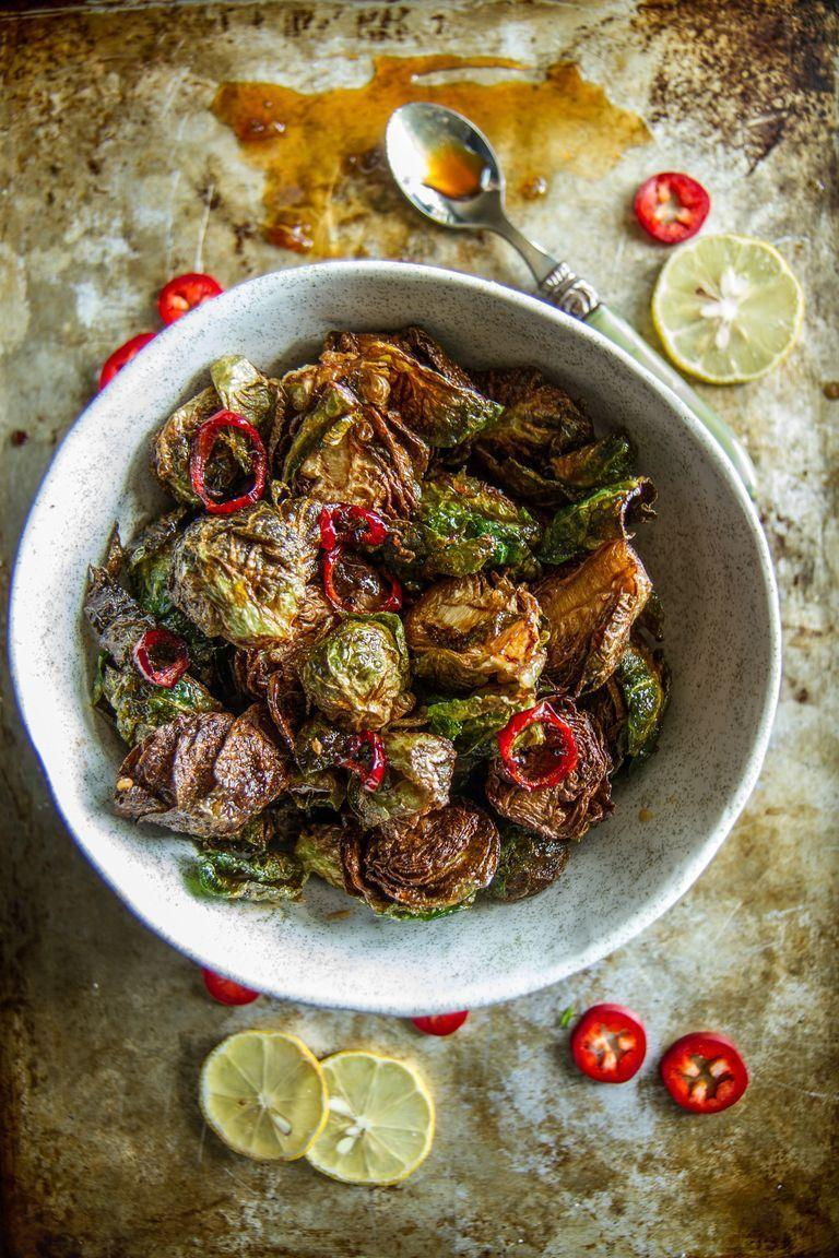 """<p>A honey Sriracha glaze makes this dish irresistible. Make sure you get the temperature right to avoid soggy sprouts.</p><p><strong>Get the recipe from <a href=""""https://www.thepioneerwoman.com/food-cooking/recipes/a79939/crispy-fried-brussels-sprouts/"""" rel=""""nofollow noopener"""" target=""""_blank"""" data-ylk=""""slk:Heather Christo"""" class=""""link rapid-noclick-resp"""">Heather Christo</a>.</strong><strong><br></strong></p>"""