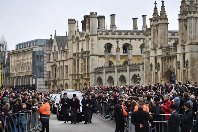 Hundreds of mourners lined the streets of Cambridge. Photo: AAP