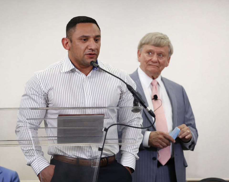 FILE - In this Jan. 26, 2021, file photo, Houston Police officer Felipe Gallegos speaks as lawyer Rusty Hardin listened during a press conference at Hilton Americas, in Houston. Gallegos, was indicted on Wednesday, July 23, 2021, in what prosecutors say are the final charges to be filed in a long running corruption probe following a 2019 Houston police drug raid in which a couple was killed. (Karen Warren/Houston Chronicle via AP, file)