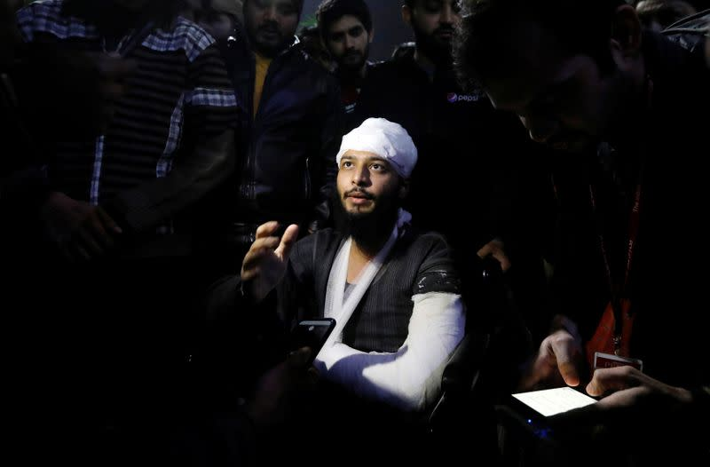 Hisham Siddiqui, a Jamia Millia Islamia university student, who was injured during a protest on Sunday, talks to media outside a hospital in New Delhi