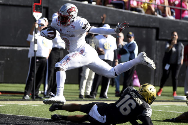 UNLV running back Charles Williams (8) scores a touchdown past Vanderbilt cornerback BJ Anderson in the first half of an NCAA college football game Saturday, Oct. 12, 2019, in Nashville, Tenn. (AP Photo/Mike Strasinger)