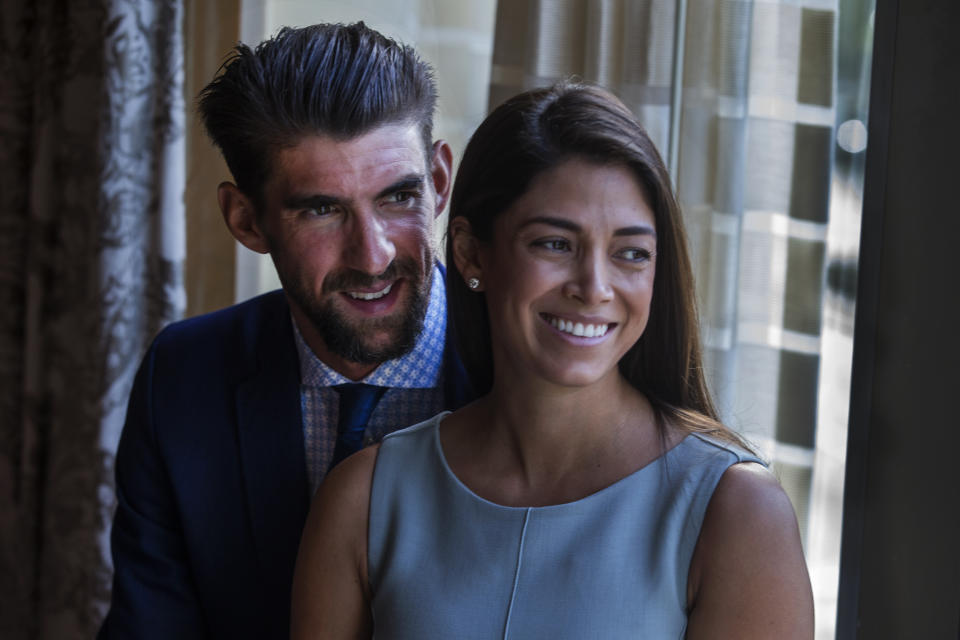 BOSTON, MA - MAY 21: Michael Phelps, the most decorated Olympian of all time, stands with his wife Nicole Johnson before receiving the Morton E. Ruderman Award in Inclusion at the Four Seasons Hotel in Boston on May 21, 2019. (Photo by Stan Grossfeld/The Boston Globe via Getty Images)