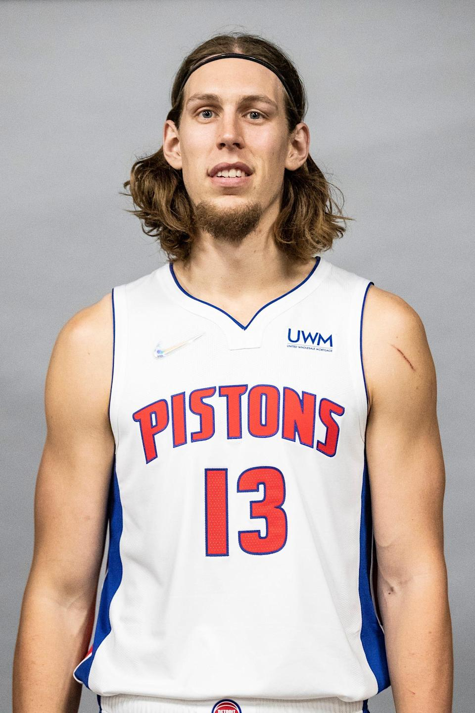 Detroit Pistons center Kelly Olynyk (13) poses for a photo during media day at the Little Caesars Arena in Detroit on Monday, Sept. 27, 2021.