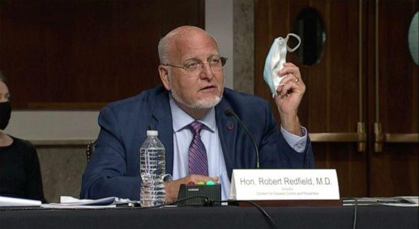 PHOTO: Centers for Disease Control and Prevention Director Dr. Robert Redfield holds up his mask as he speaks at a Senate Appropriations subcommittee hearing, Sept. 16, 2020, in Washington. (ABC News)