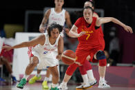 Puerto Rico's Jennifer O'Neill (0) and China's Ting Shao (7) chase a loose ball during a women's basketball preliminary round game at the 2020 Summer Olympics in Saitama, Japan, Tuesday, July 27, 2021. (AP Photo/Charlie Neibergall)