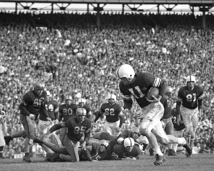 FILE - In this Jan. 2, 1950 file phto, Oklahoma quarterback Darrell Royal (11) sweeps around the LSU line on his way to a touchdown during the fourth quarter of the Sugar Bowl NCAA college football game in New Orleans. Royal, who won two national championships and turned the Texas program into a national power, died early Wednesday, Nov. 7, 2012, at age 88 of complications from cardiovascular disease, school spokesman Bill Little said. Royal also had suffered from Alzheimer's disease. AP Photo/File)