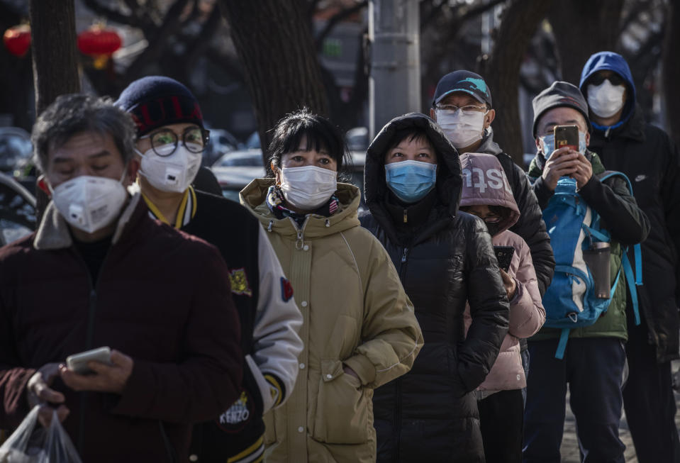 BEIJING, CHINA - FEBRUARY 16: Chinese customers wear protective masks as they line up single file to buy dumplings at a popular local shop on February 16, 2020 in Beijing, China. The number of cases of the deadly new coronavirus COVID-19 rose to more than 57000 in mainland China Sunday, in what the World Health Organization (WHO) has declared a global public health emergency. China continued to lock down the city of Wuhan in an effort to contain the spread of the pneumonia-like disease which medicals experts have confirmed can be passed from human to human. In an unprecedented move, Chinese authorities have maintained and in some cases tightened the travel restrictions on the city which is the epicentre of the virus and also in municipalities in other parts of the country affecting tens of millions of people. The number of those who have died from the virus in China climbed to over 1650 on Sunday, mostly in Hubei province, and cases have been reported in other countries including the United States, Canada, Australia, Japan, South Korea, India, the United Kingdom, Germany, France and several others. The World Health Organization has warned all governments to be on alert and screening has been stepped up at airports around the world. Some countries, including the United States, have put restrictions on Chinese travellers entering and advised their citizens against travel to China. (Photo by Kevin Frayer/Getty Images)