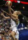Minnesota Lynx forward Rachel Jarry (12) pushes the ball up to the basket against New York Liberty forward DeLisha Milton-Jones (1) in the second half of a WNBA basketball game, Sunday, Aug. 18, 2013, in Minneapolis. The Lynx won 88-57. (AP Photo/Stacy Bengs)