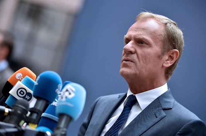 European Council President Donald Tusk talks to the press as he arrives before an EU summit meeting on June 28, 2016 (AFP Photo/Philippe Huguen)