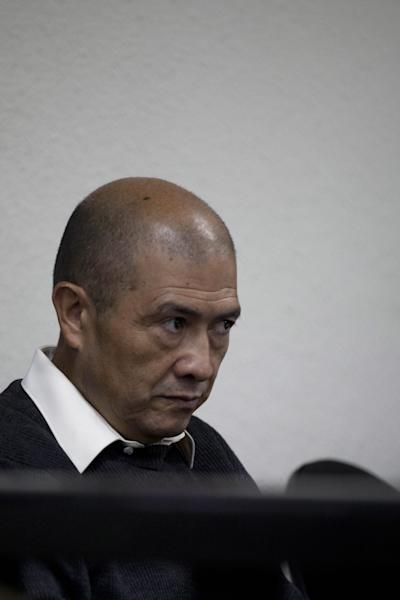 Ex-guerrilla Fermin Felipe Solano Barrillas, who is charged with taking part in a 1988 massacre of more than 20 men, listens to testimony during the El Aguacate Massacre trial in Chimaltenango, Guatemala, Thursday, March 13, 2014. In November 1988 in the mountainous area of western Guatemala, 22 men who lived in the village of El Aguacate where massacred by leftists guerillas during the Guatemalan civil war. The trial that began Thursday, is the first against an ex-guerrilla, who is charged with taking part in the massacre. (AP Photo/Moises Castillo)
